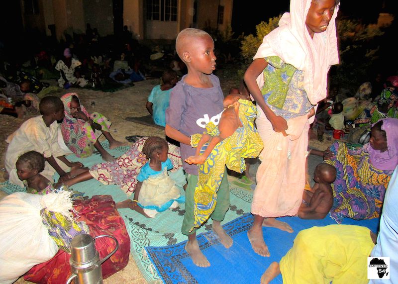 Boy carring malnourished brother site