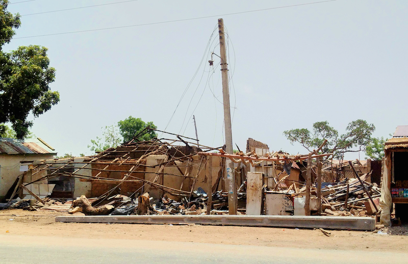 Destroyed homes in Mobi site