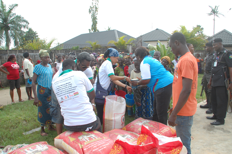 Giving rice to the old women