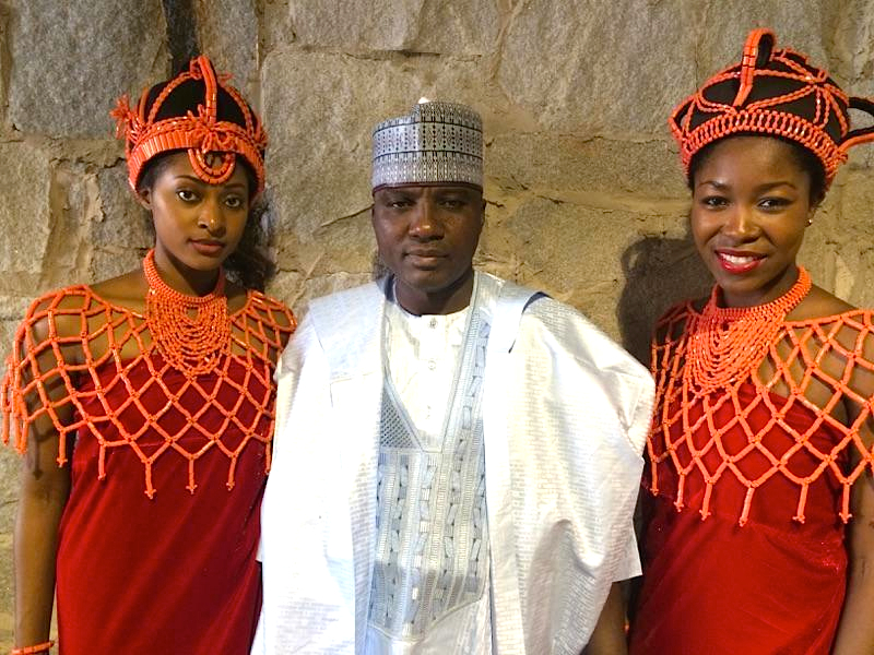 Isa Gusau and hostesses dressed in Royal Benin attire