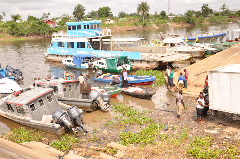 Loading speed boats with rice for creek trip
