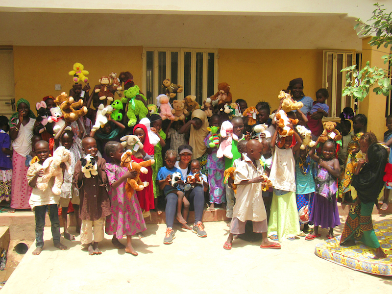 Modupe and rescued children with their new toys site