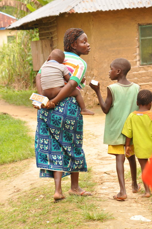 Mother and children taking home their free medication