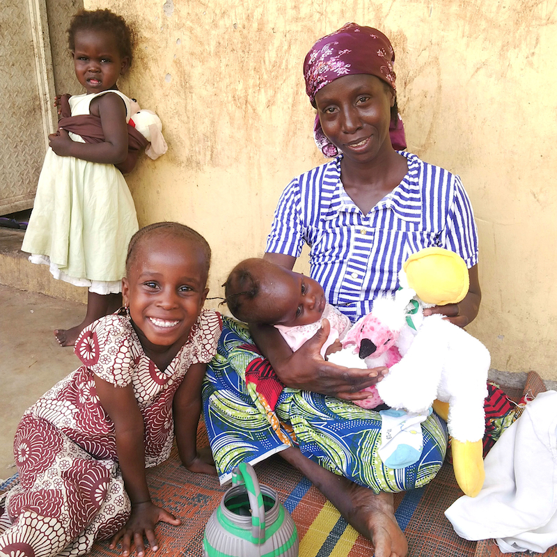 Rescued woman and children from Sambisa happy to receive toys and clothes site