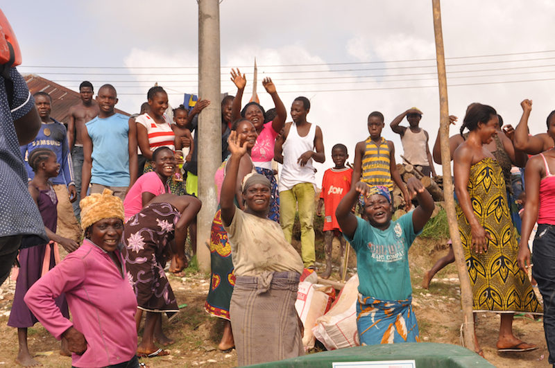 Women happily receiving bags of rice