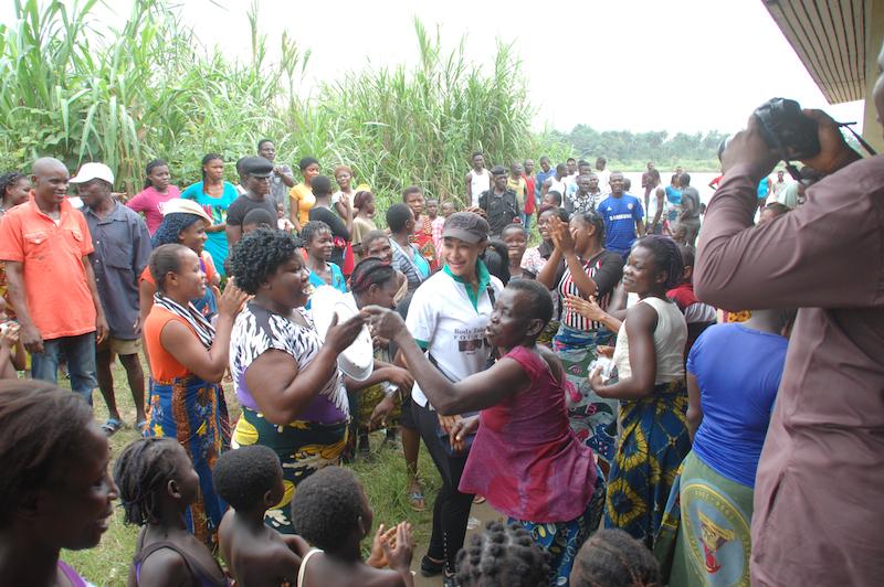 Women of Anyama-Ijaw dancing upon receiving bags of rice and free medical treatment