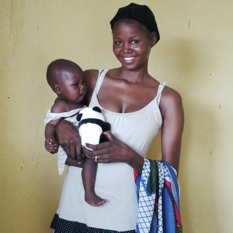 rescued woman and baby with toy site