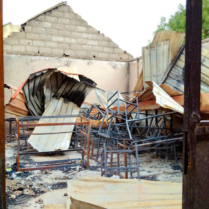school tables and chairs burnt site