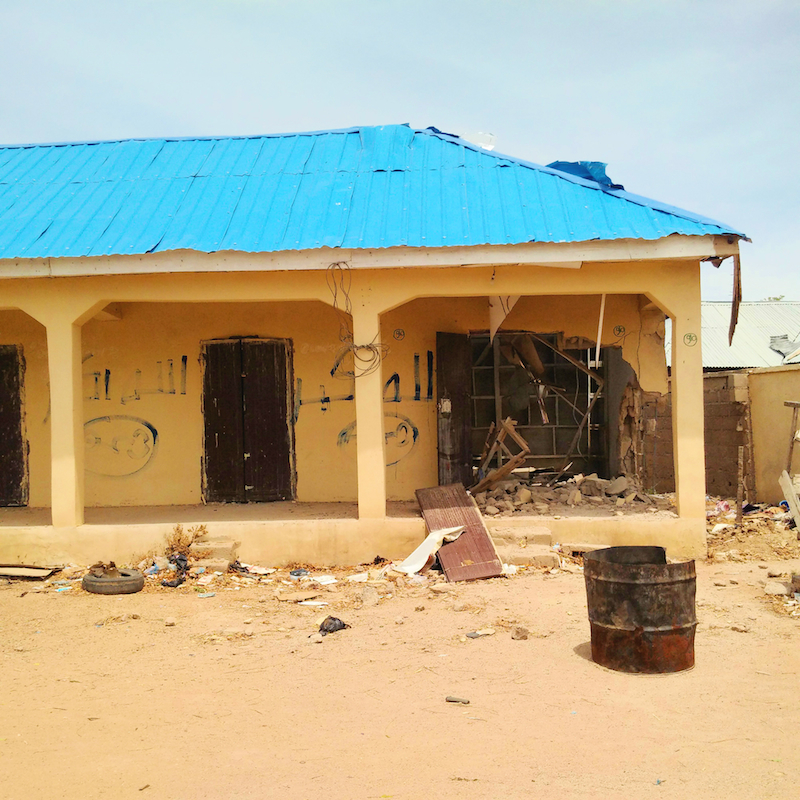 shops destroyed and islamic writings on building by Boko Haram, Maraba-Mubi site