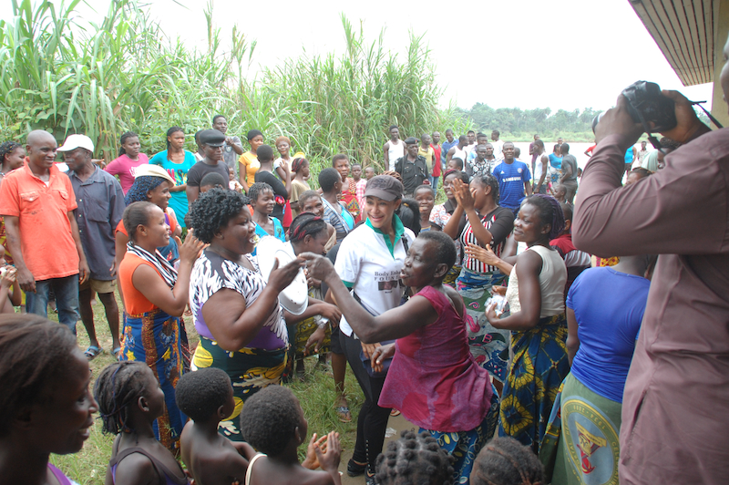 Princess Modupe Ozolua dancing in Anyama Ijaw with the local women